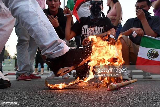A Trump hat burns during a protest near where Republican presidential candidate Donald Trump held a rally in San Jose California on June 02 2016...