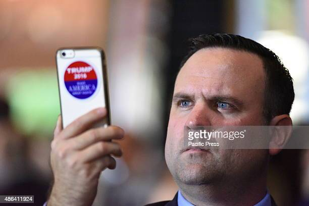 Trump staffer makes smart phone video of attendees at Trump Tower press conference Republican candidate for president Donald Trump announced he had...