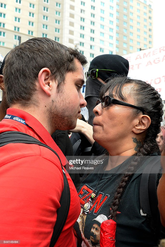 Trump supporter Devin Bilski, left, and anti-Trump protestor Brenda Carrasco stare down each other face-to-face outside the Western Conservative Summit on July 1, 2016.