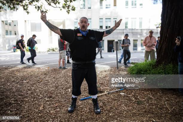 Trump supporter gestures after being taunted to fight by an antiTrump protester during a proDonald Trump rally at Martin Luther King Jr Civic Center...