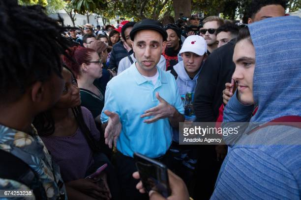 Trump supporter holds a discussion with antiTrump protesters during a proDonald Trump rally at Martin Luther King Jr Civic Center Park in Berkeley...