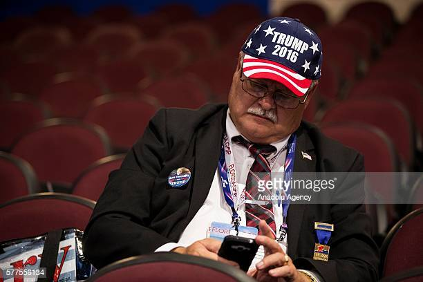 Trump supporter sits on his phone during a break in the 2016 Republican National Convention in Cleveland Ohio USA on July 18 2016