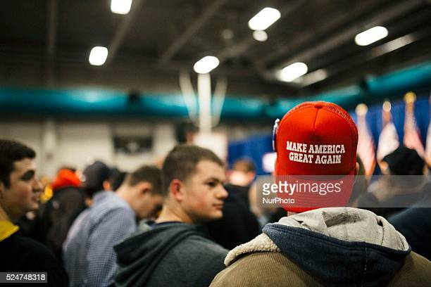 Trump supporter wears a hat saying make america great again wait for the arrival of Republican presidential candidate Donald Trump during his...