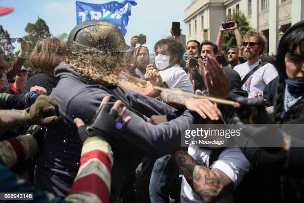 Trump supporters are pepper sprayed during a clash with protesters at a 'Patriots Day' free speech rally on April 15 2017 in Berkeley California More...