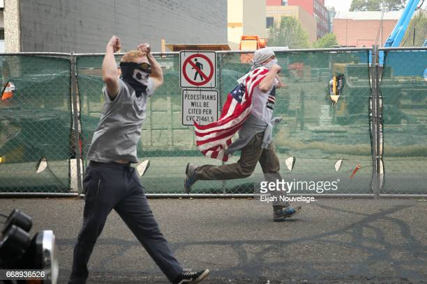 Trump supporters chase after protesters at a 'Patriots Day' free speech rally on April 15 2017 in Berkeley California More than a dozen people were...