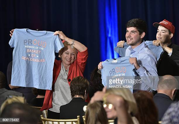 Trump supporters hold tshirts refering to a comment made by Democratic presidential nominee Hillary Clinton ahead of a campaign event by Republican...