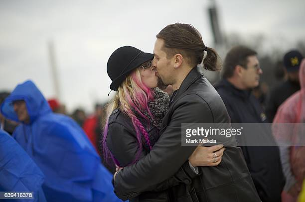 Jesslynn McCauley and Josh Kreger kiss during the inauguration address of Donald Trump after he was sworn in as the 45th President of the United...