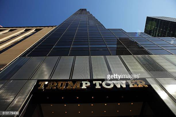 Trump Tower stands along 5th Avenue in Manhattan as police stand guard outside following an earlier protest against Republican presidential candidate...
