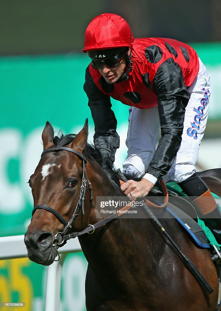 Trumpet Major ridden by <a gi-track='captionPersonalityLinkClicked' href=/galleries/search?phrase=Richard+Hughes+-+Jockey&family=editorial&specificpeople=206680 ng-click='$event.stopPropagation()'>Richard Hughes</a> (red cap) wins The bet365.com Mile at Sandown Park on April 26, 2013 in Esher, England.