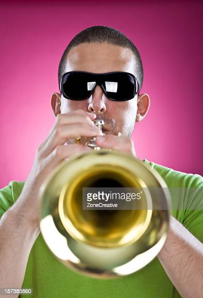 trumpet man musician play on pink background