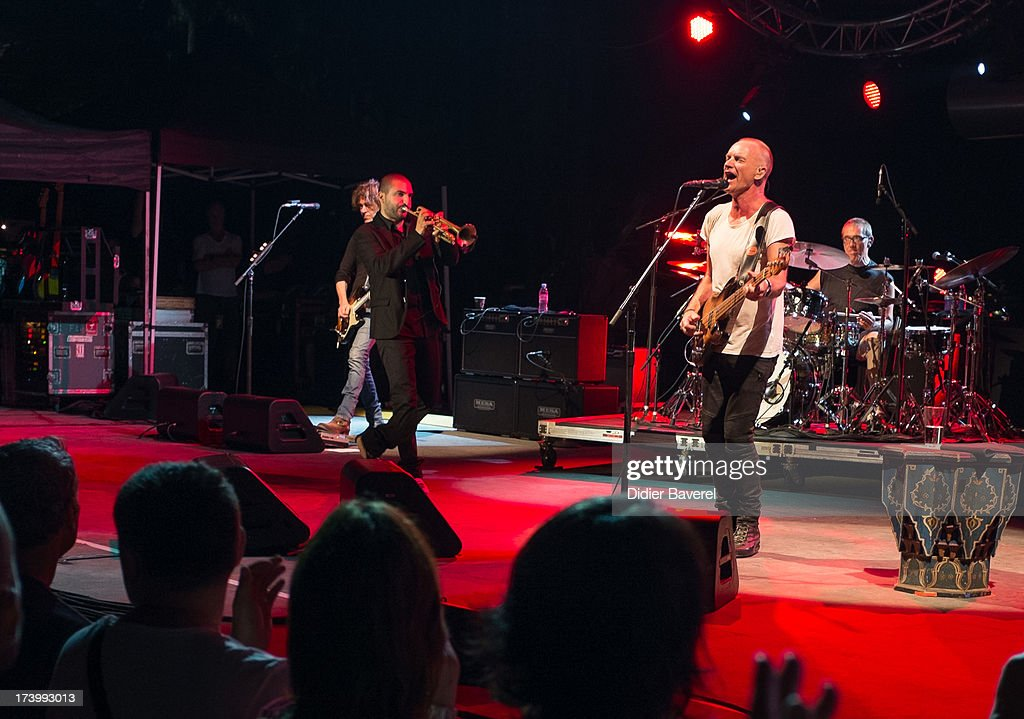 Trumpet player Ibrahim Maalouf joins Singer STING and performs on stage with him at Juan-Les-Pins Jazz Festival on July 18, 2013 in Juan-les-Pins, France.