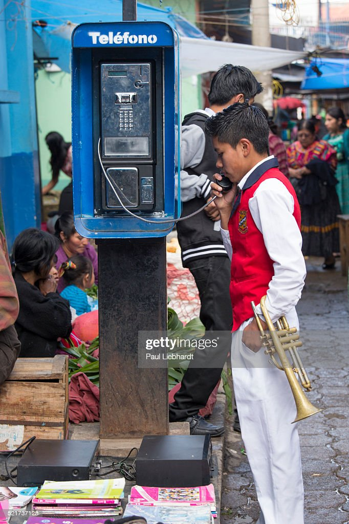 Trumpet Player Makes a Pay Phone Call