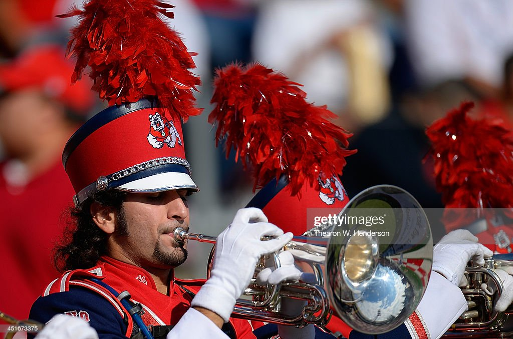 A trumpet player of the Fresno State Bulldogs marching band performs prior to the start of their NCAA football game against New Mexico Lobos at Bulldog Stadium on November 23, 2013 in Fresno, California.