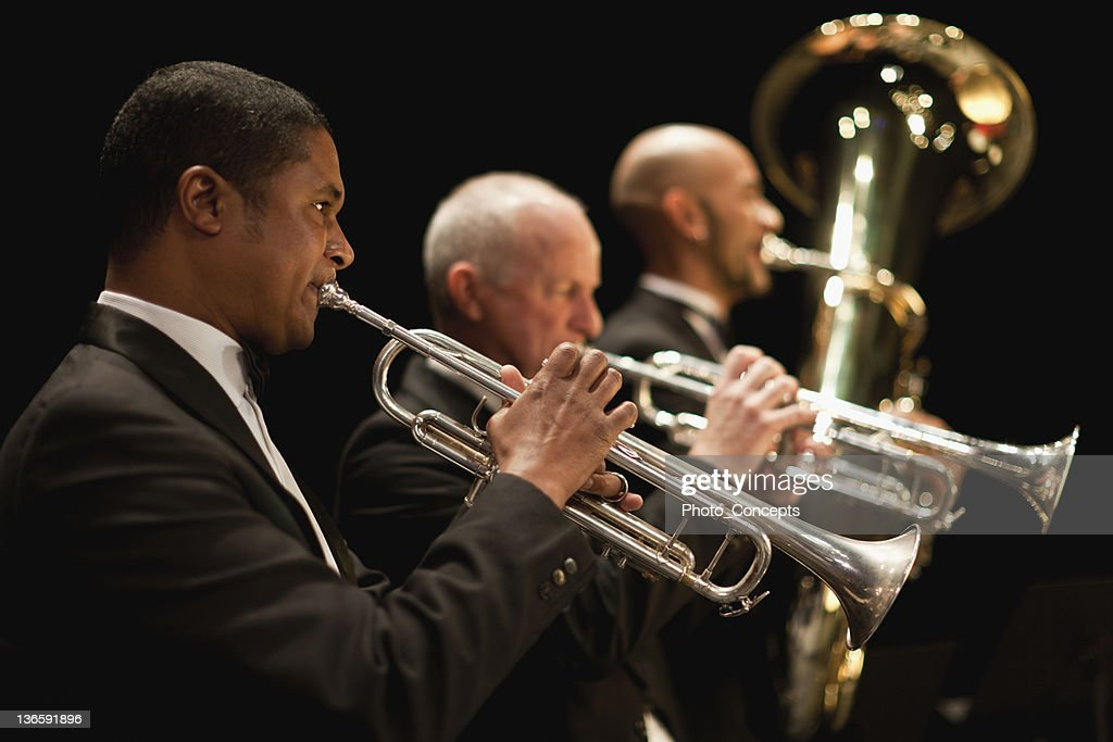Trumpet players in orchestra : Stock Photo