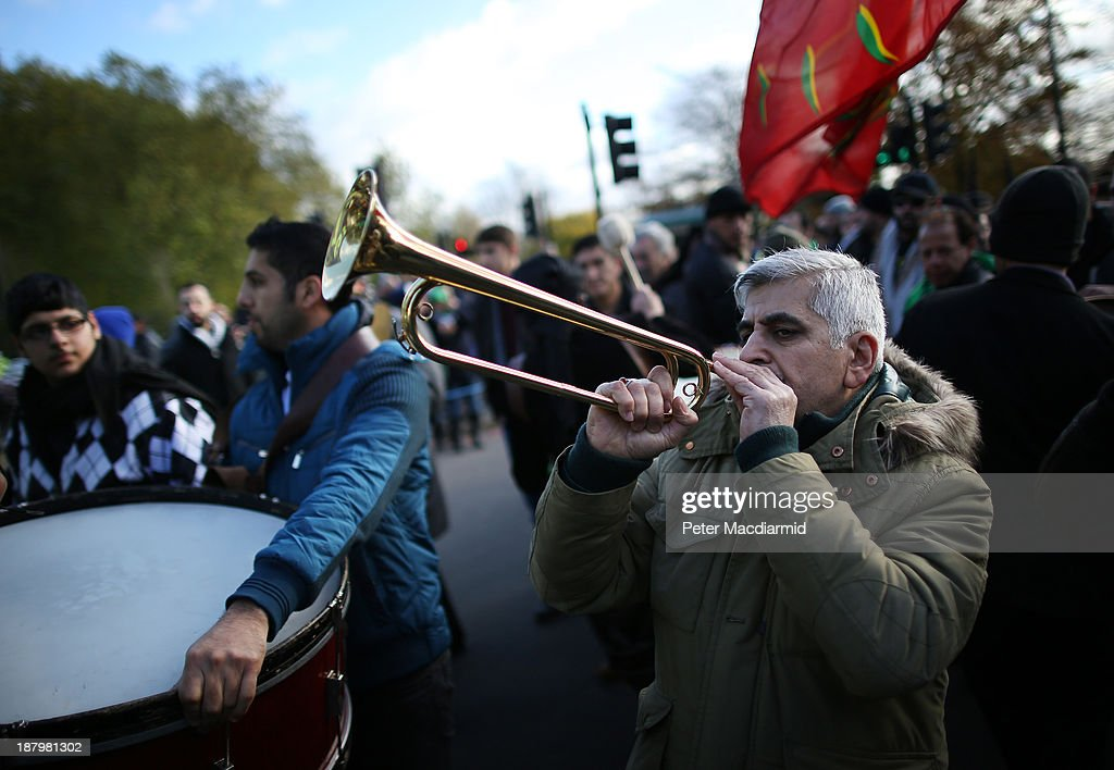 A trumpeter heralds the start of a Shia Muslims Ashura day mourning procession on November 14, 2013 in London, England. Ashura is a day of solemn mourning for the martyrdom of Hussein in 680 AD.
