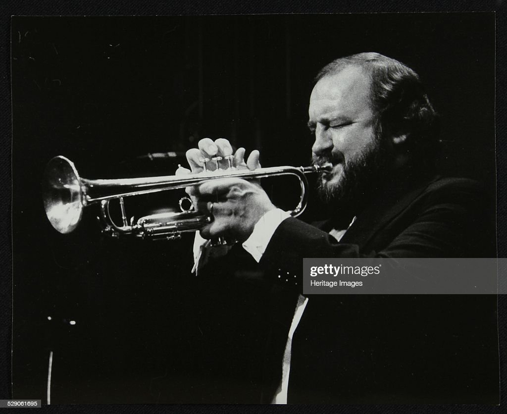 Trumpeter Keith Smith playing at Stevenage Hertfordshire 1984 Artist Denis Williams