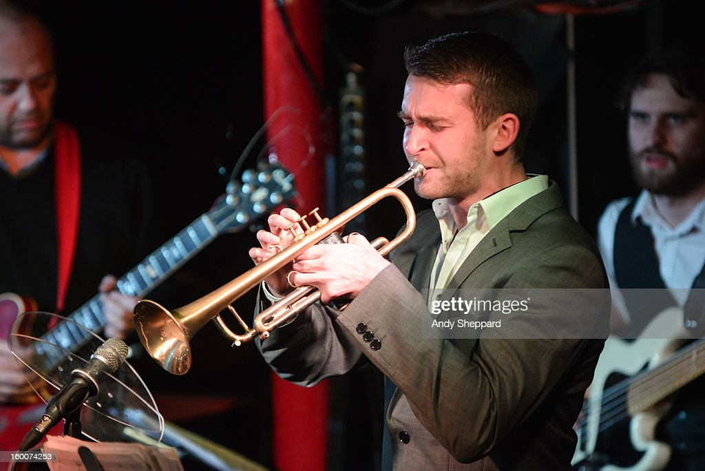 Trumpeter Mark Perry performs on stage with Ola Onabule at Pizza Express Jazz Club on January 25, 2013 in London, England.