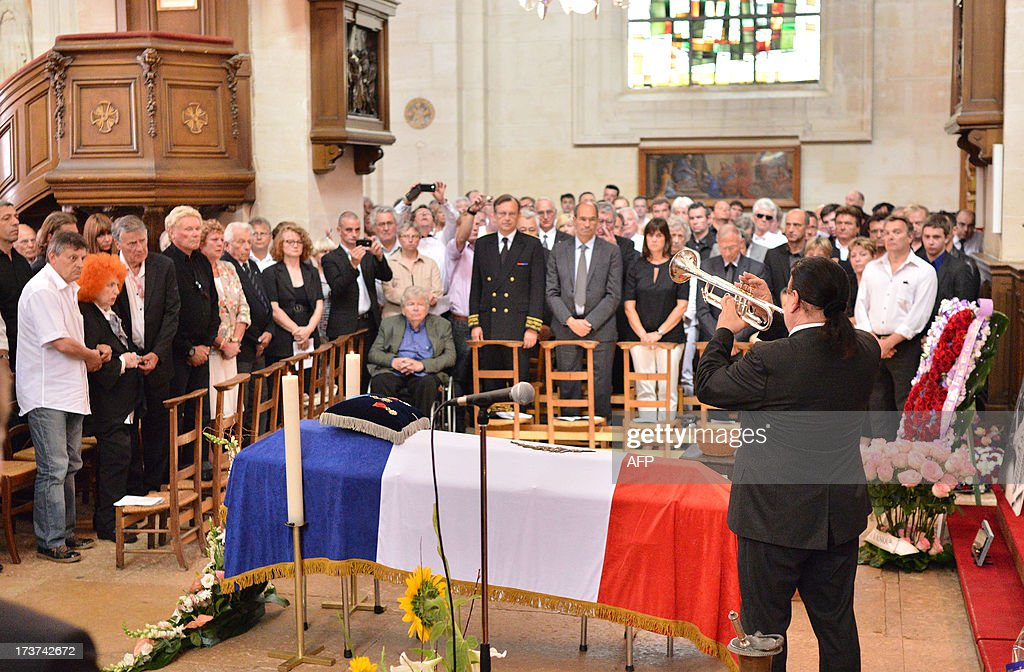 A trumpeter perfoms in front of the coffin of French accordion player legend Andre Verchuren during the religious ceremony , in Chantilly, north of Paris, on July 17, 2013. Verchuren died of an heart attack at age 92, on July 10, 2013.