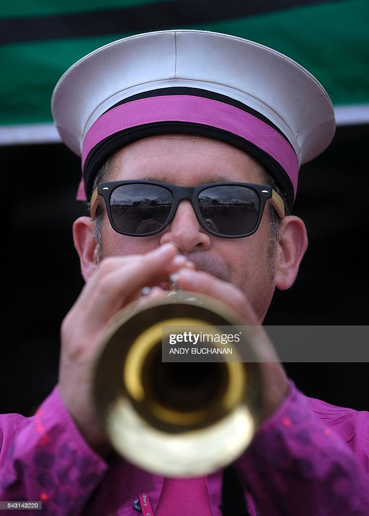 A trumpeter performs on day five of the Glastonbury Festival of Music and Performing Arts on Worthy Farm near the village of Pilton in Somerset, South West England on June 26, 2016. / AFP / Andy Buchanan
