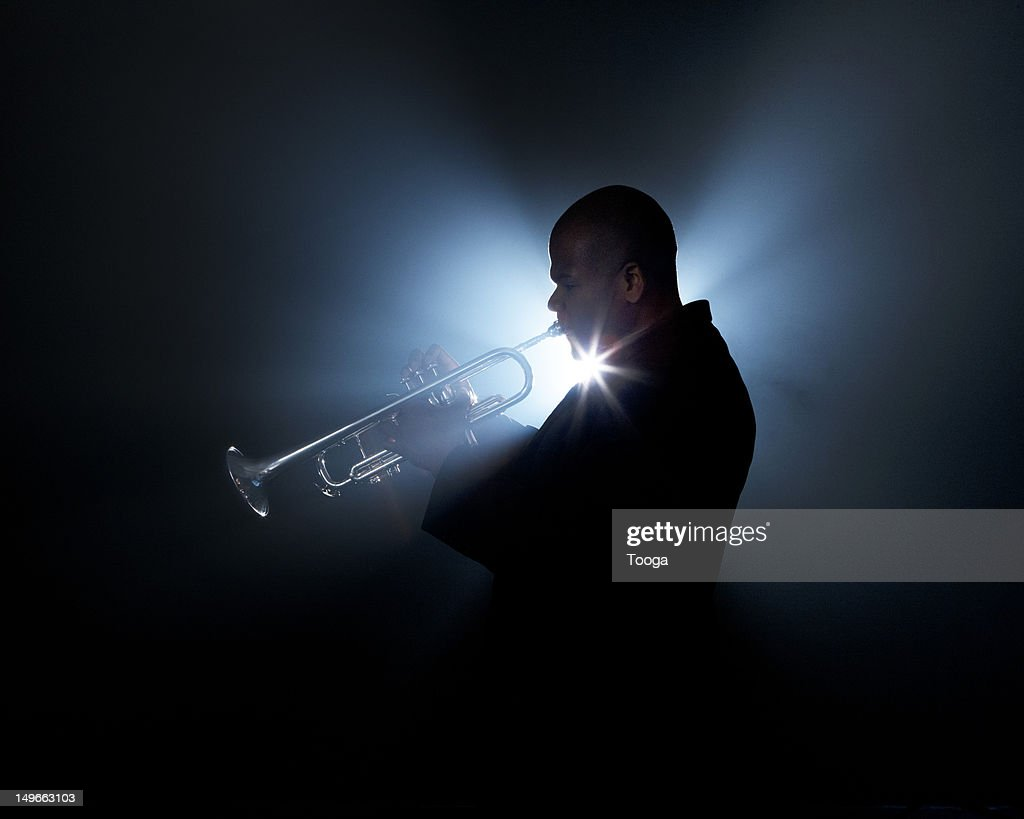 Trumpeter playing horn on stage