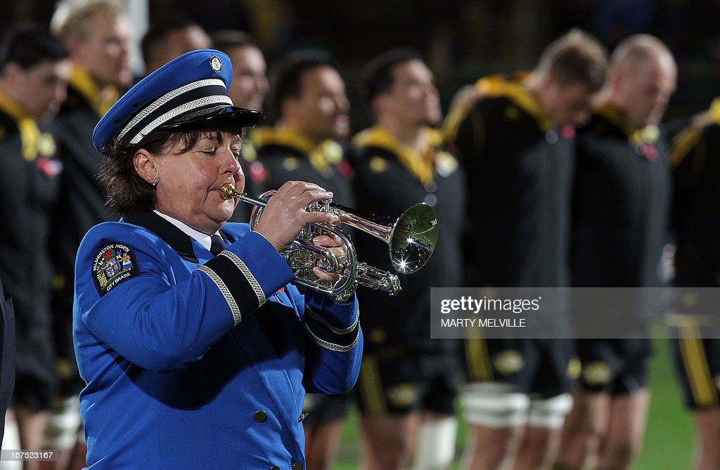A trumpeter plays the last post as playsers stand in respect of Anzac day (the previous day) during a rugby union Super 15 match between the Western Stormers and Wellington Hurricanes at the FMG Stadium in Palmerston North on April 26, 2013.