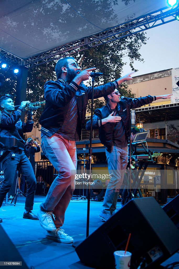 Trumpeter Spencer Ludwig and singers Sebu Simonian and Ryan Merchant of Capital Cities perform at the 2013 Grove summer concert series at The Grove on July 24, 2013 in Los Angeles, California.