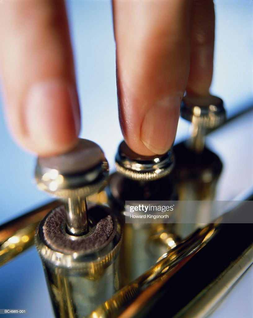 Trumpeter's fingers on valves, close-up : Stock Photo