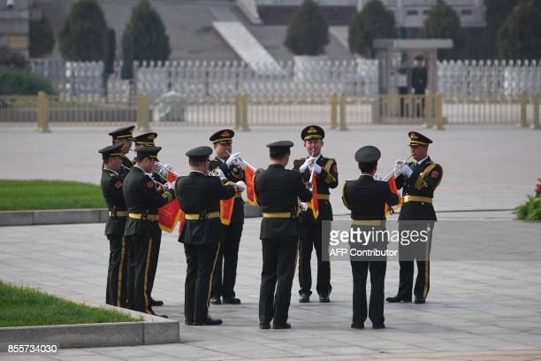 Trumpeters rehearse before a ceremony to mark Martyrs Day in Tianmanmen Square on the eve of China's National Day in Beijing on September 30 2017...