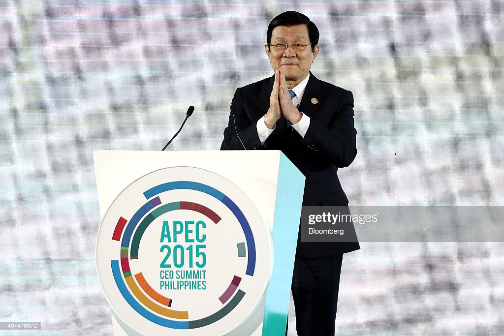 Truong Tan Sang, Vietnam's president, greets attendees at the Asia-Pacific Economic Cooperation (APEC) CEO Summit in Manila, the Philippines, on Tuesday, Nov. 17, 2015. Vietnam's relationship with China is important, Sang said. Photographer: SeongJoon Cho/Bloomberg via Getty Images