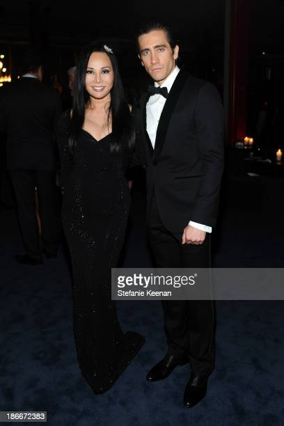 Trustee and CoChair Eva Chow and actor Jake Gyllenhaal wearing Gucci attend the LACMA 2013 Art Film Gala honoring Martin Scorsese and David Hockney...