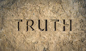 Conceptual Image Of The Word Truith Chiselled Into Stone Or Rock