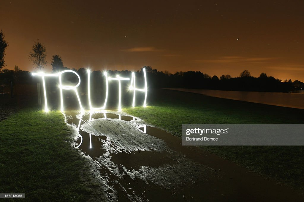 'Truth' written in light in a rural setting : Stock Photo