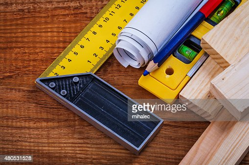 Try square pencil blueprints wooden studs construction level on : Stock Photo