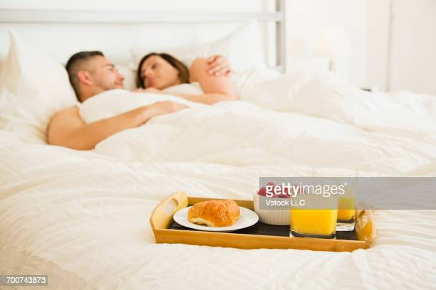 Try with breakfast on bed with couple in background
