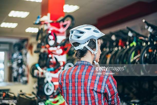 Trying new sports helmet in the bike shop