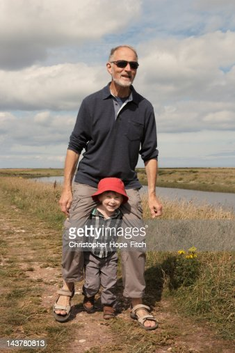 Trying to carry grandad : Stock Photo