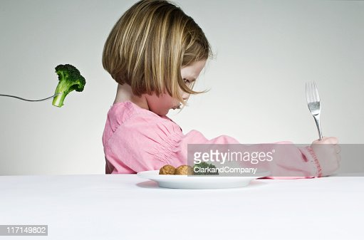 Trying To Get a Young Girl to Eat Her Greens