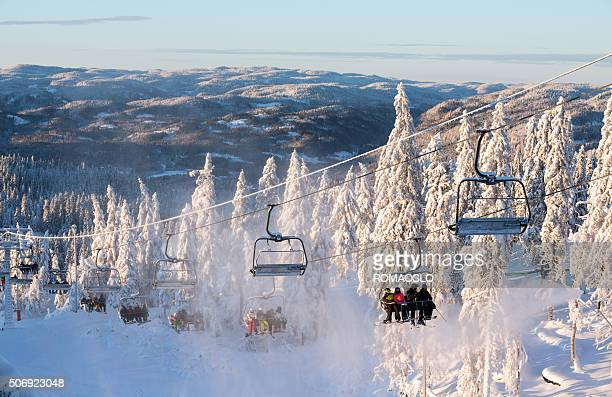 Tryvann ski resort with skiers taking the lift, Oslo Norway