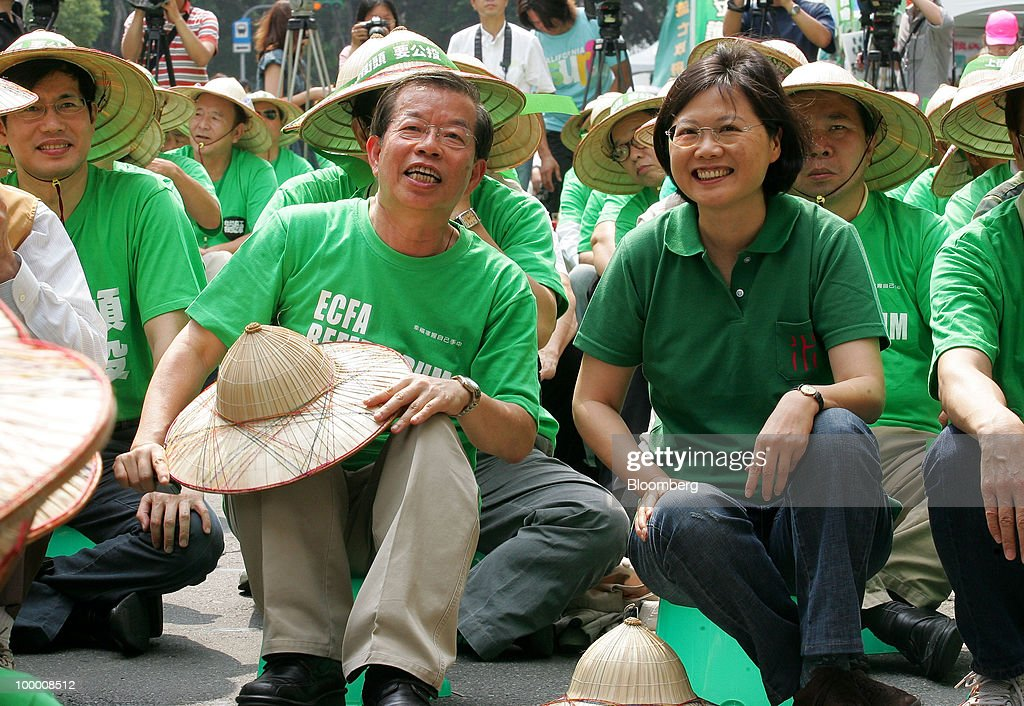 Tsai Ing-wen, chairwoman of Taiwan's main opposition Democratic Progressive Party (DPP), right, and Frank Hsieh, Taiwan's former premier, left, lead supporters at a sit-in protest in Taipei, Taiwan, on Thursday, May 20, 2010. President Ma Ying-jeou has pushed for the trade agreement with China to prevent Taiwan from being 'marginalized' after a Chinese accord with the 10-member Association of Southeast Asian Nations took effect this year. The proposal sparked opposition demonstrations amid concern China may boost its influence over Taiwan. Photographer: Maurice Tsai/Bloomberg via Getty Images
