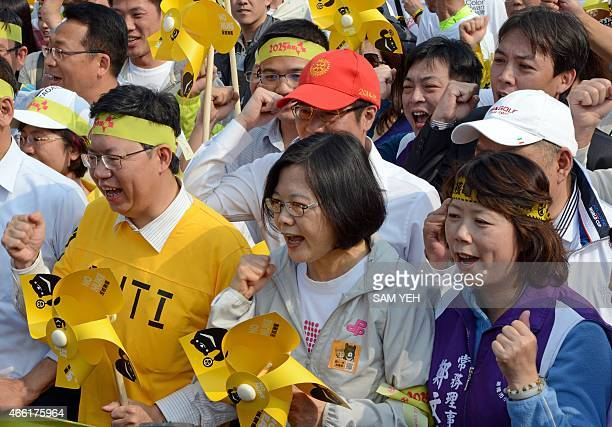 Tsai Ingwen chairwoman of the main opposition Democratic Progressive Party chants slogans during an antinuclear rally in Taipei on March 14 2015...