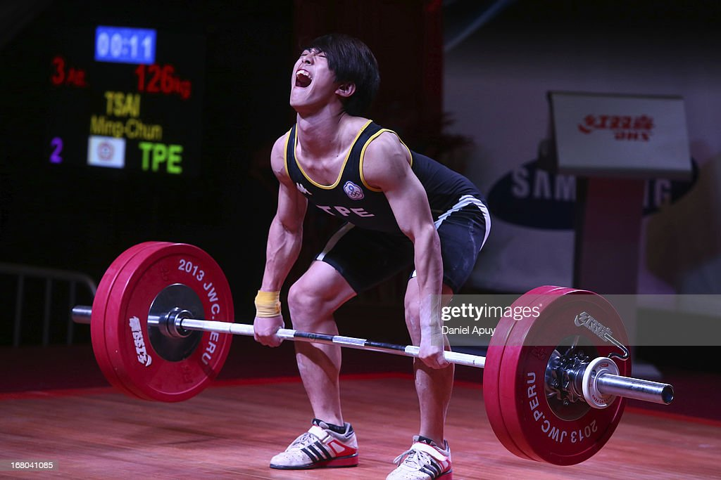 Tsai Ming-Chun of Chinese Taipie B competes in the Men's 56kg during day one of the 2013 Junior Weightlifting World Championship at Maria Angola Convention Center on April 04, 2013 in Lima, Peru.