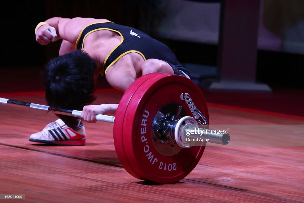 Tsai Ming-Chun of Chinese Taipie B laments after faiiling in the Men's 56kg during day one of the 2013 Junior Weightlifting World Championship at Maria Angola Convention Center on April 04, 2013 in Lima, Peru.