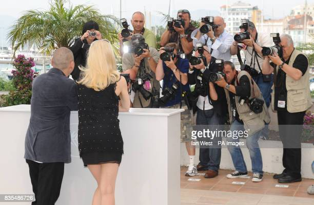 Tsai MingLiang and Laetitia Casta attend a photocall for new film Visage during the Cannes Film Festival at the Palais de Festival in Cannes France