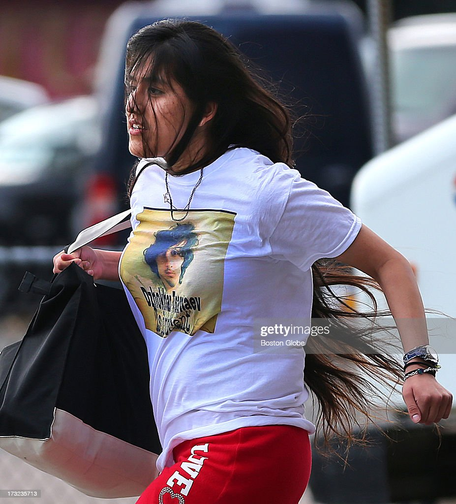 A Tsarnaev supporter wearing a t-shirt that says 'Dzhokhar Tsarnaev is innocent' runs away from the media as she left the courthouse. Alleged Boston Marathon bomber Dzhokhar Tsarnaev appeared for an arraignment at the John Joseph Moakley United States Courthouse to face charges in the Boston Marathon bombings.
