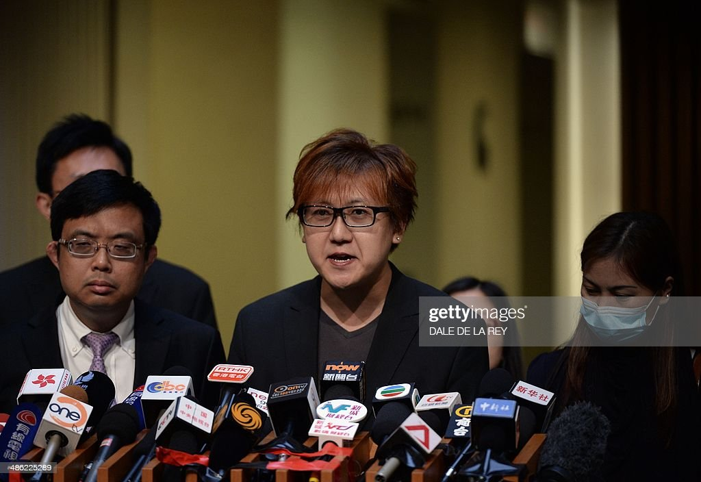 Tse Chi-kin (C), brother of Masa Tse, a victim of the 2010 Manila bus hijacking crisis, speaks alongside hostage survivor Yik Siu-ling (R) and relatives of victims during a press conference in Hong Kong on April 23, 2014. The Hong Kong government said on April 23 a long-running dispute with the Philippines over a deadly hostage crisis had ended following a deal on an apology and compensation.