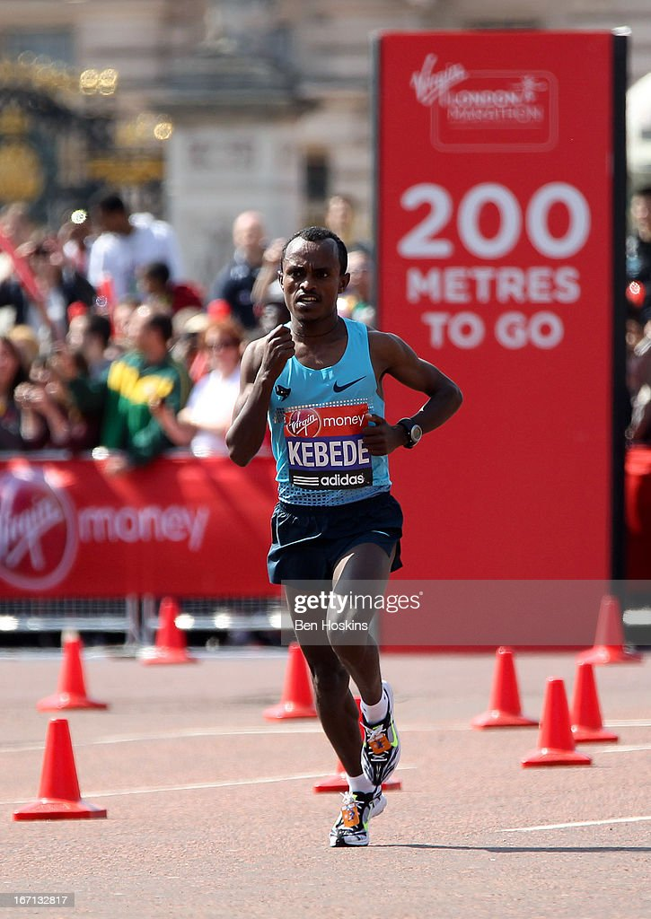 Tsegaye Kebede of Ethiopia makes his way down The Mall towards the finish line and winning the mens elite race during the Virgin London Marathon 2013 on April 21, 2013 in London, England.