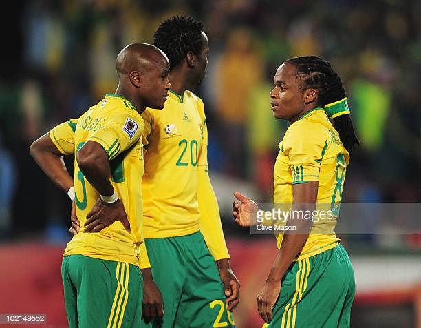 Tsepo Masilela Bongani Khumalo and Siphiwe Tshabalala of South Africa are dejected after defeat in the 2010 FIFA World Cup South Africa Group A match...