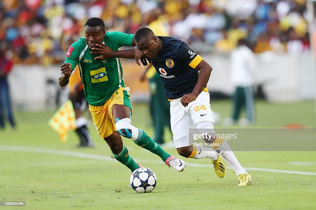 Tsepo Masilela holds off Thamsanqa Gabuza during the Absa Premiership match between Golden Arrows and Kaizer Chiefs at Moses Mabhida Stadium on April 06, 2013 in Durban, South Africa.