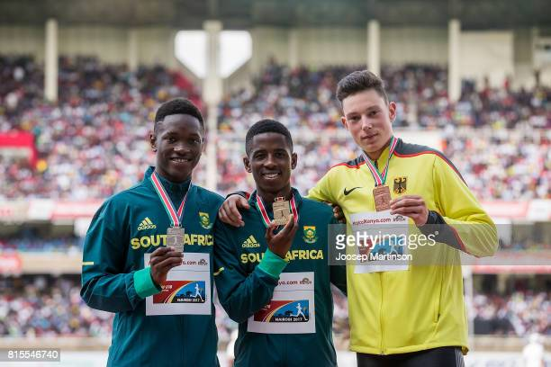Tshenolo Lemao and Retshidisitswe Mlenga of South Africa and Luis Brandner of Germany pose in the boys 200m medal ceremony of during day 5 of the...
