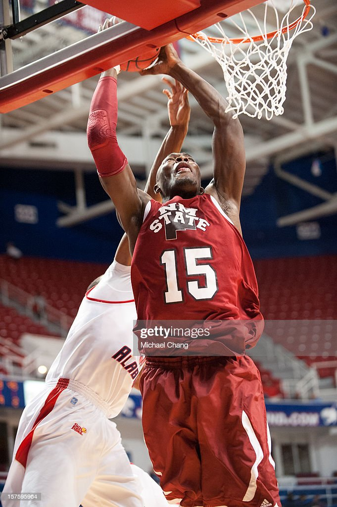 Tshilidzi Nephawe #15 of the New Mexico State Aggies attempts to dunk the ball over Javier Carter #32 of the South Alabama Jaguars at USA Mitchell Center on December 4, 2012 in Mobile, Alabama. At halftime New Mexico State leads South Alabama 31-25.